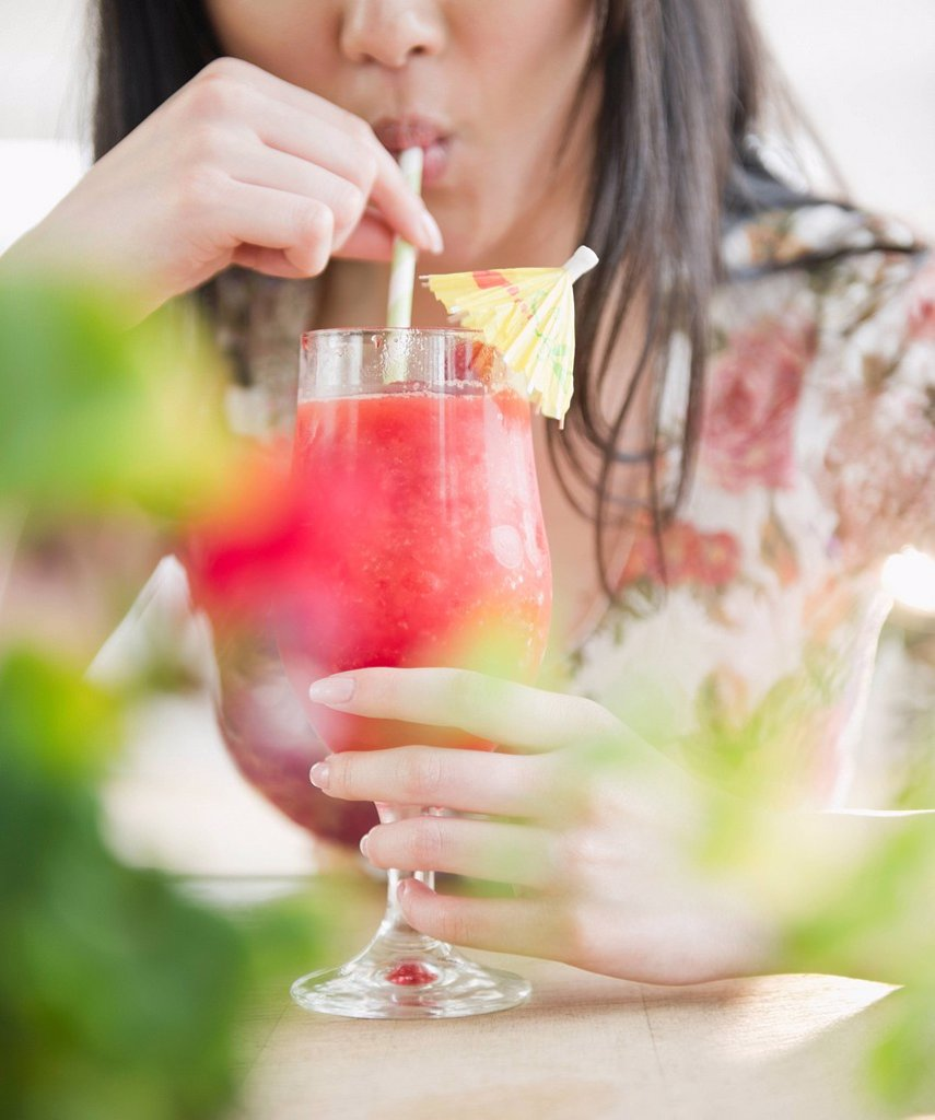 Korean woman drinking tropical cocktail : Stock Photo