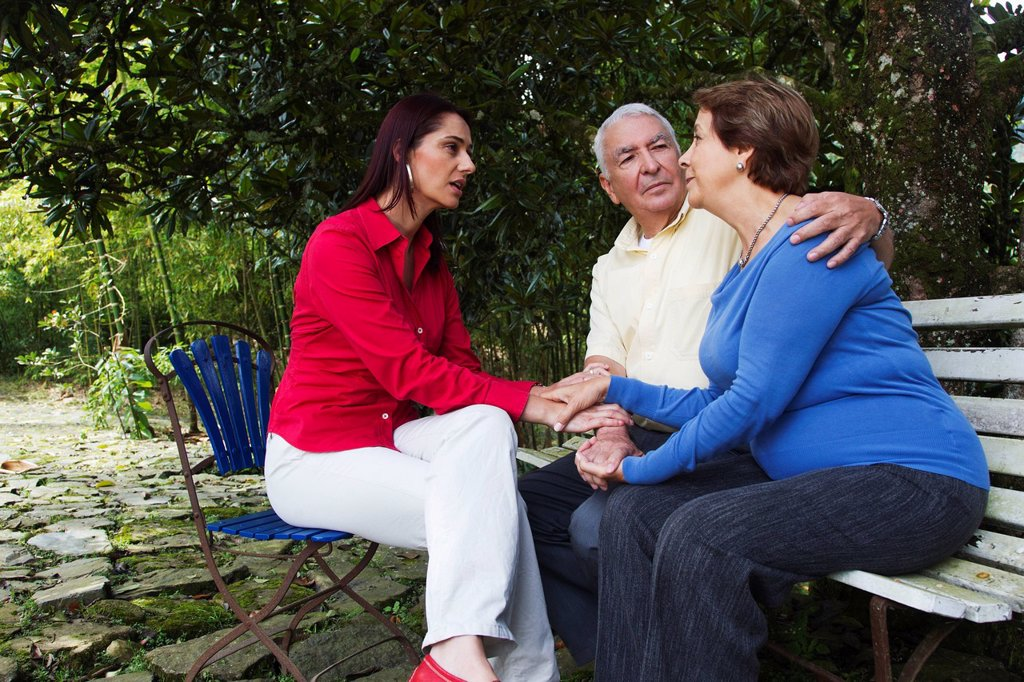 Stock Photo: 1589R-146505 Hispanic woman giving senior Hispanic couple bad news