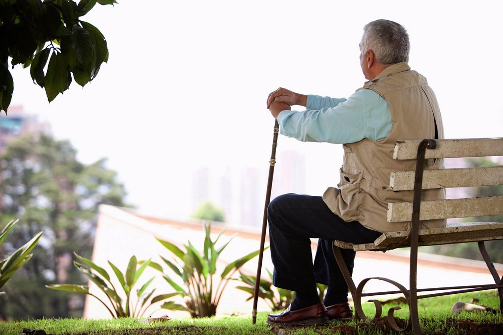 Stock Photo: 1589R-146535 Senior man sitting on park bench