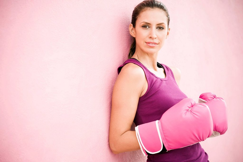 Stock Photo: 1589R-146855 Hispanic woman in boxing gloves