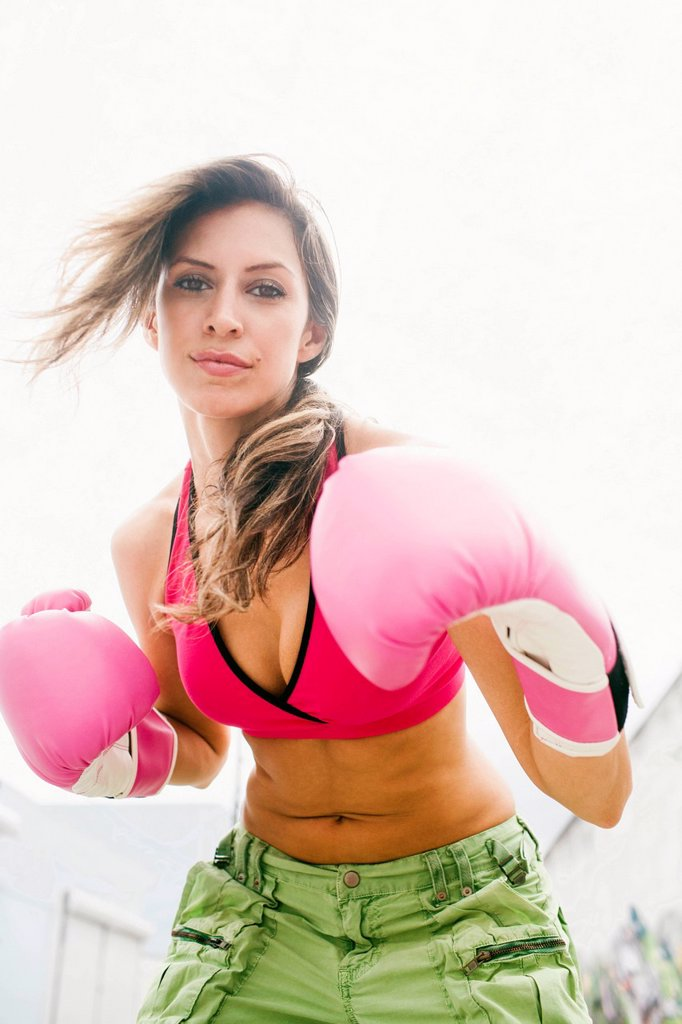 Hispanic woman in boxing gloves : Stock Photo