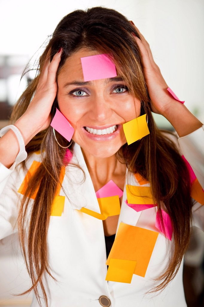 Stock Photo: 1589R-146980 Hispanic businesswoman covered in sticky notes