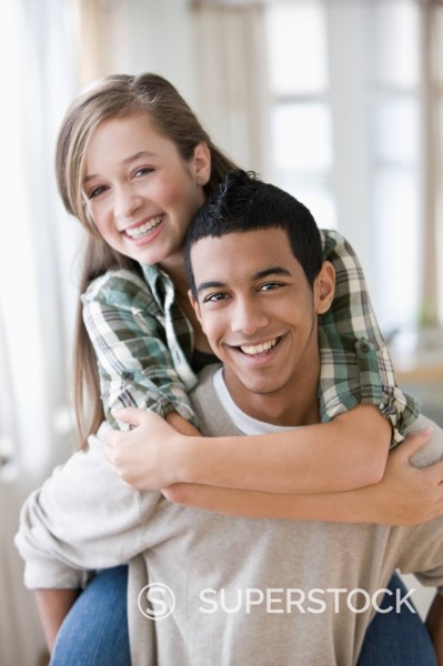 Stock Photo: 1589R-147298 Teenage boy giving girlfriend a piggyback ride