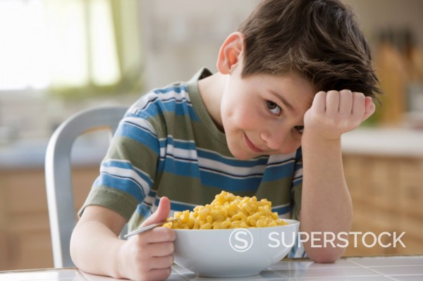 Stock Photo: 1589R-147572 Caucasian boy eating macaroni and cheese
