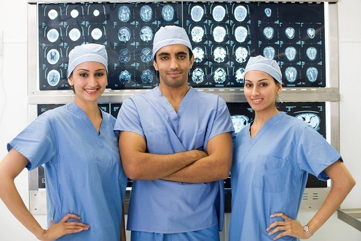 Doctors standing near x_rays in hospital : Stock Photo