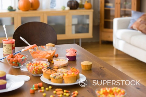 Stock Photo: 1589R-149068 Table with cupcakes and candy decorations