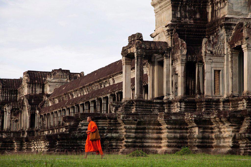 Stock Photo: 1589R-149290 Priest walking near Angkor Wat temple