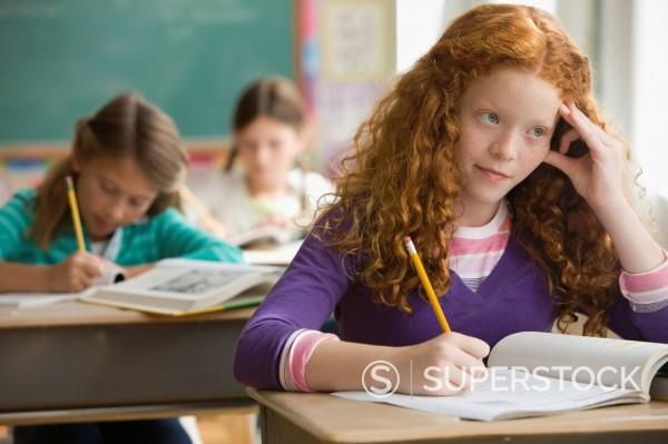 Stock Photo: 1589R-149488 Students doing school work in classroom