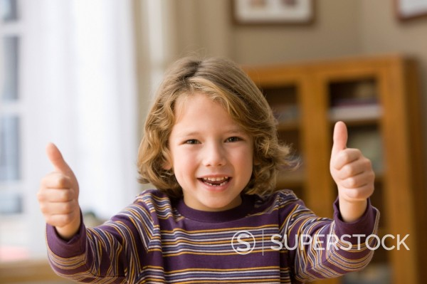 Stock Photo: 1589R-149536 Caucasian boy giving thumbs up