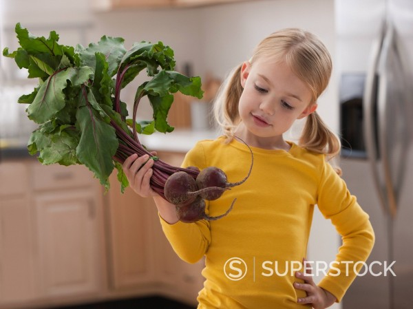 Stock Photo: 1589R-149645 Caucasian girl looking at beets
