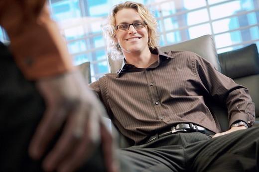 Stock Photo: 1589R-149706 Smiling Caucasian businessman