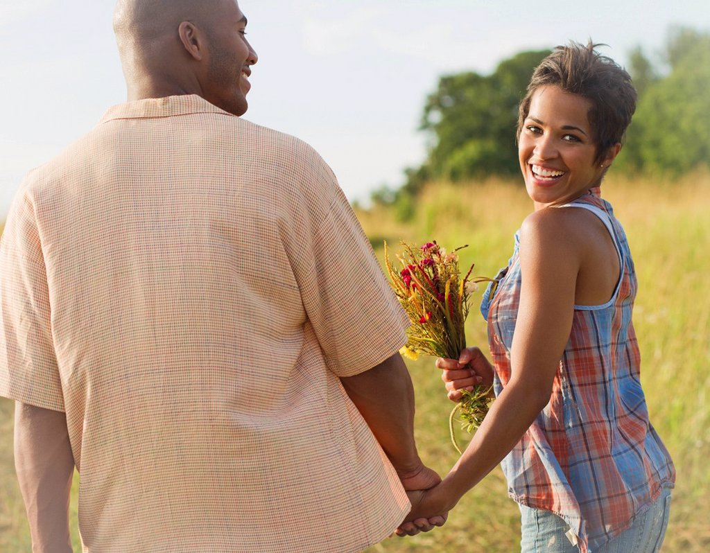 Stock Photo: 1589R-150379 Woman with flowers holding hands with husband
