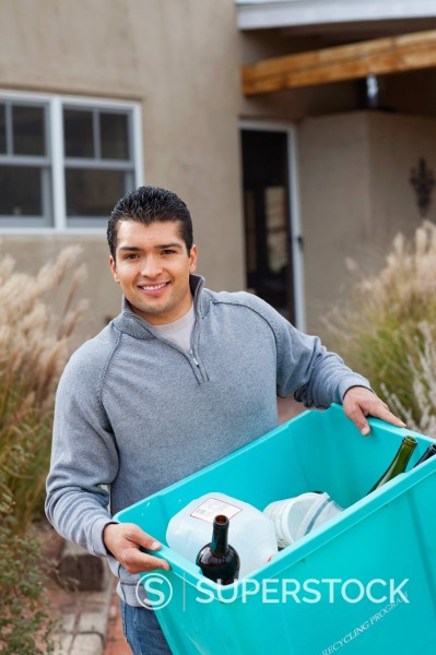 Stock Photo: 1589R-150503 Hispanic man carrying recycling bin