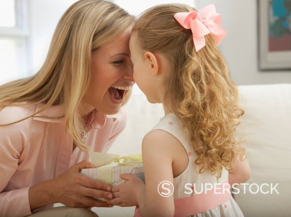 Stock Photo: 1589R-150521 Caucasian daughter giving mother a gift