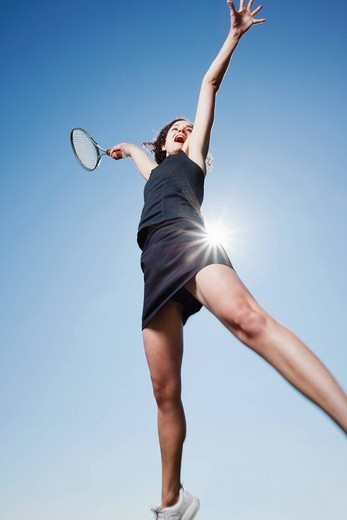 Caucasian woman playing tennis : Stock Photo