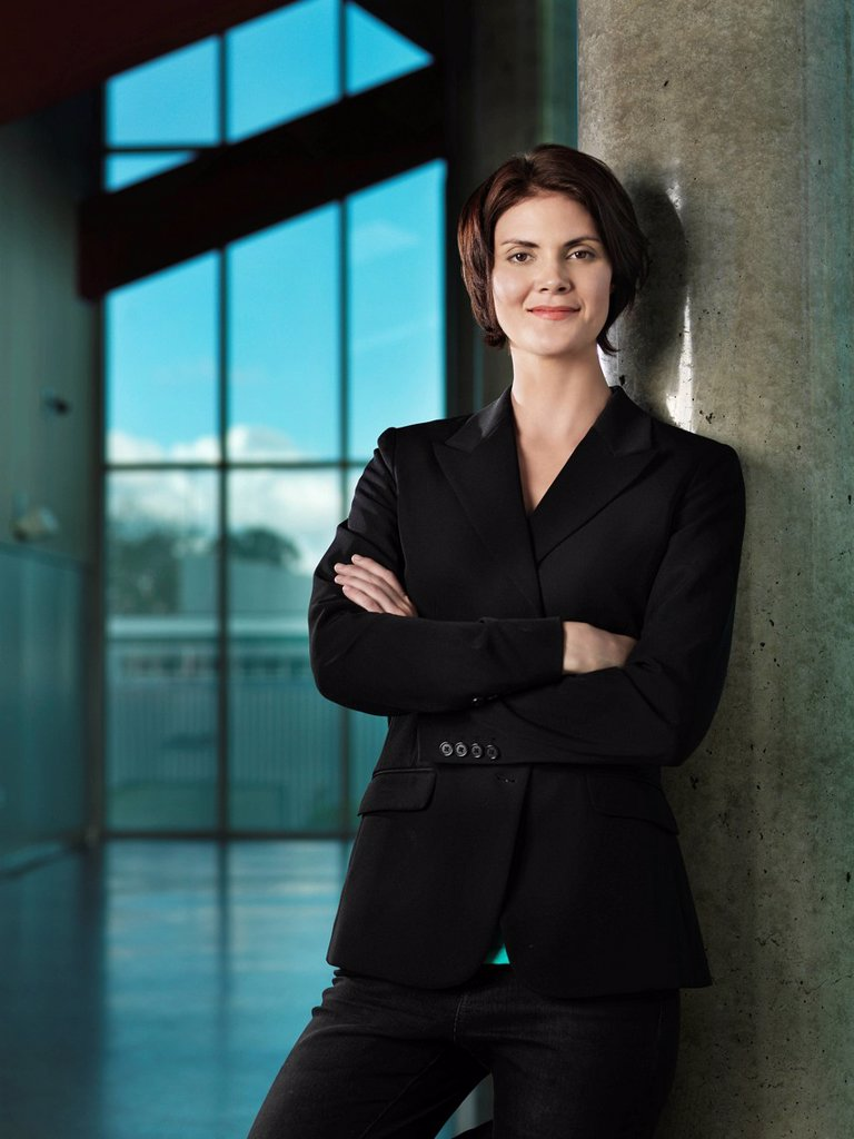 Caucasian businesswoman with arms crossed : Stock Photo