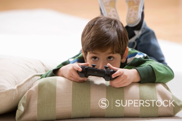 Stock Photo: 1589R-151428 Caucasian boy playing video game