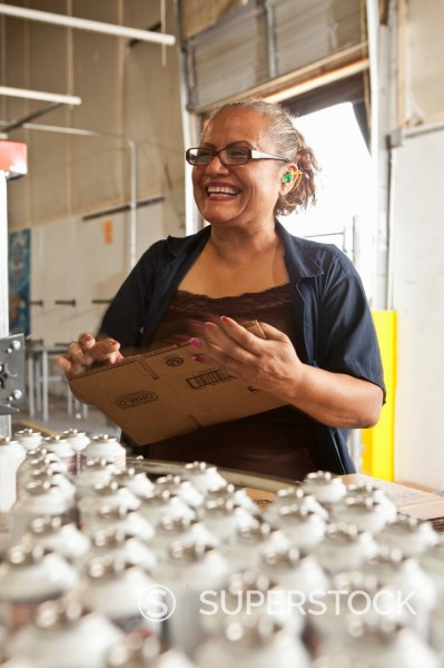 Stock Photo: 1589R-151447 Hispanic worker packing boxes on assembly line