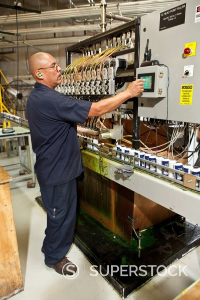 Stock Photo: 1589R-151584 Hispanic worker operating factory control panel