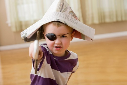Caucasian boy dressed as a pirate : Stock Photo