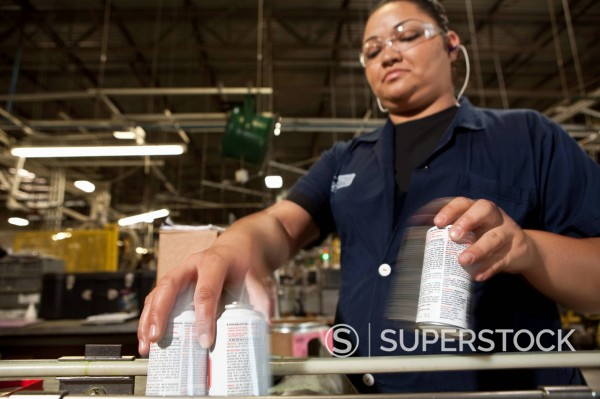 Stock Photo: 1589R-152127 Hispanic worker picking up cans from assembly line