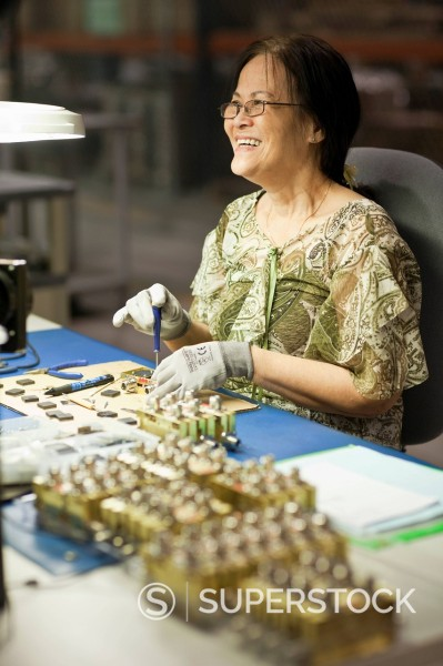 Stock Photo: 1589R-152532 Asian woman working in electronics factory
