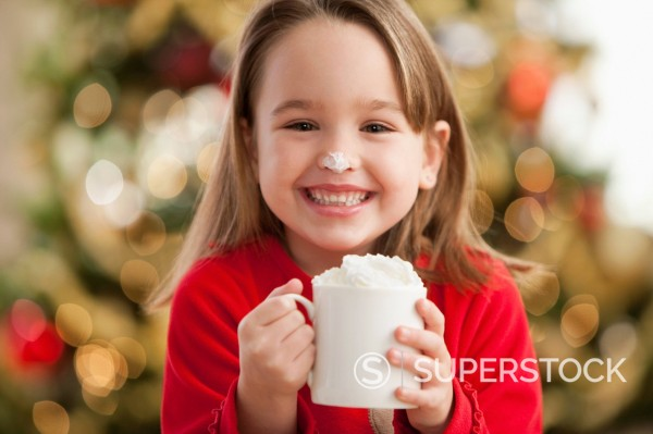 Stock Photo: 1589R-152639 Caucasian girl drinking hot chocolate at Christmastime
