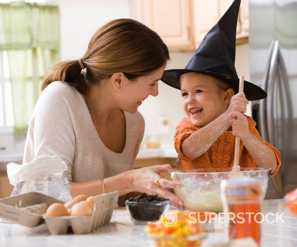 Stock Photo: 1589R-152683 Caucasian mother and witch daughter baking together
