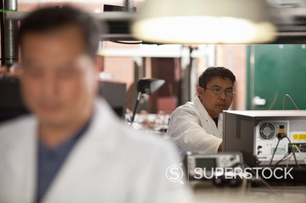 Stock Photo: 1589R-152729 Asian man working in electronics factory