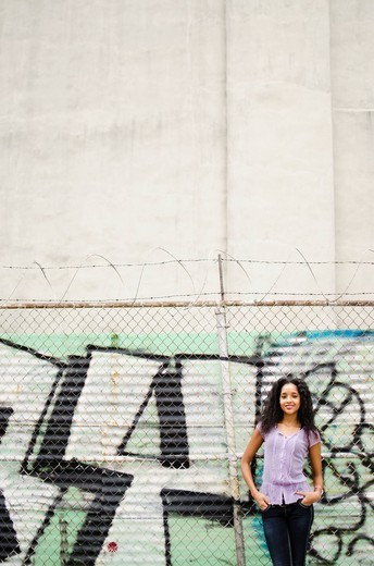 Middle eastern woman standing near graffiti : Stock Photo