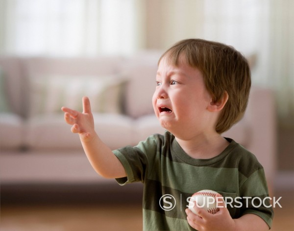 Stock Photo: 1589R-153220 Mixed race boy crying and holding baseball