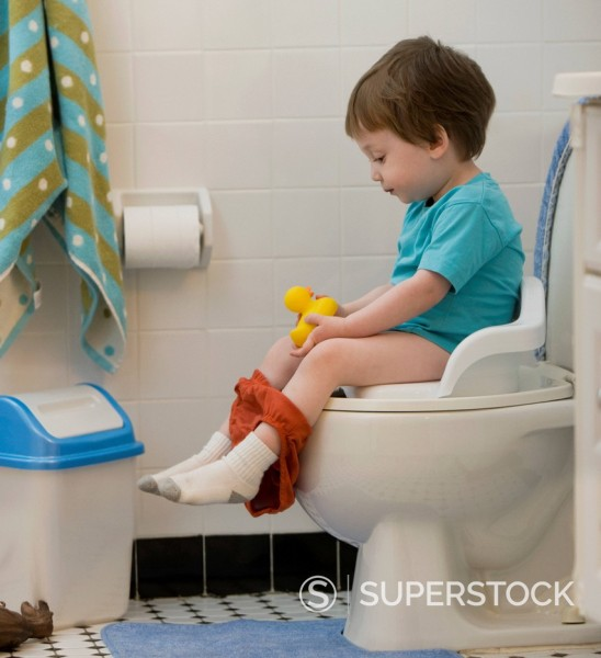 Stock Photo: 1589R-153224 Mixed race boy using toilet