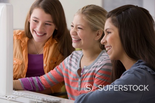 Stock Photo: 1589R-153315 Girls using computer together