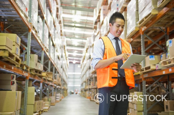 Stock Photo: 1589R-154162 Manager using digital tablet in warehouse