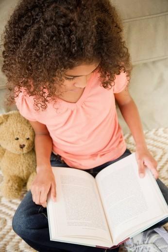 Stock Photo: 1589R-155748 Mixed race girl reading book