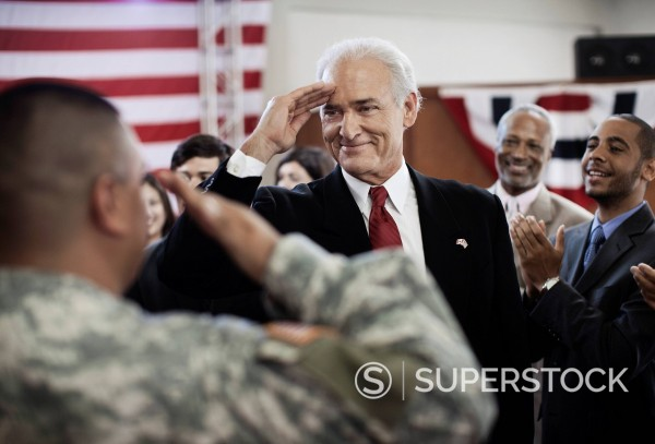 Stock Photo: 1589R-156092 Soldier saluting politician at political gathering