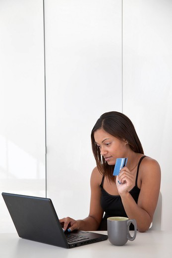 Black woman shopping online with credit card : Stock Photo