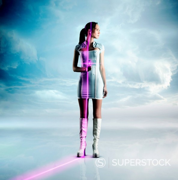 Stock Photo: 1589R-156380 Futuristic Pacific Islander woman holding glowing screen