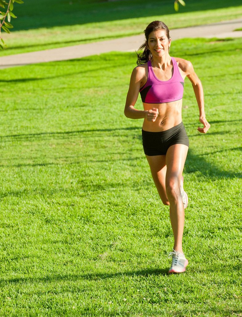 Stock Photo: 1589R-156473 Hispanic woman running in park