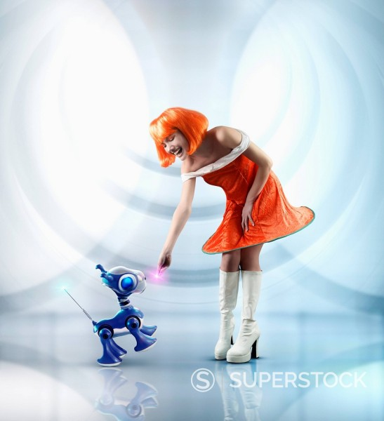 Stock Photo: 1589R-156651 Futuristic Pacific Islander woman playing with robot dog