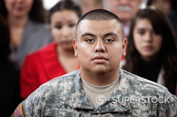 Serious Hispanic soldier : Stock Photo