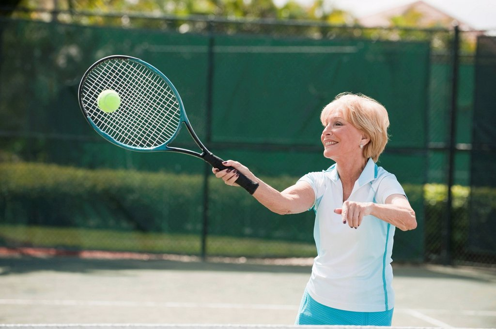 Stock Photo: 1589R-157302 Caucasian woman playing tennis