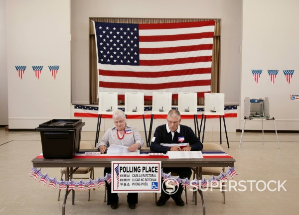 Stock Photo: 1589R-157472 Caucasian man and woman working at polling place