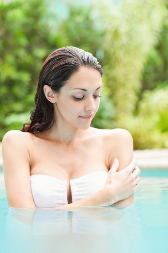 Caucasian woman enjoying swimming pool : Stock Photo