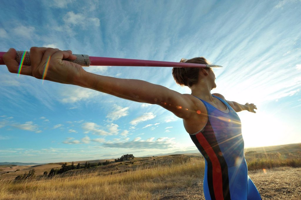 Caucasian athlete aiming javelin : Stock Photo