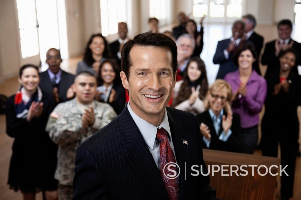 Supporters clapping for politician : Stock Photo