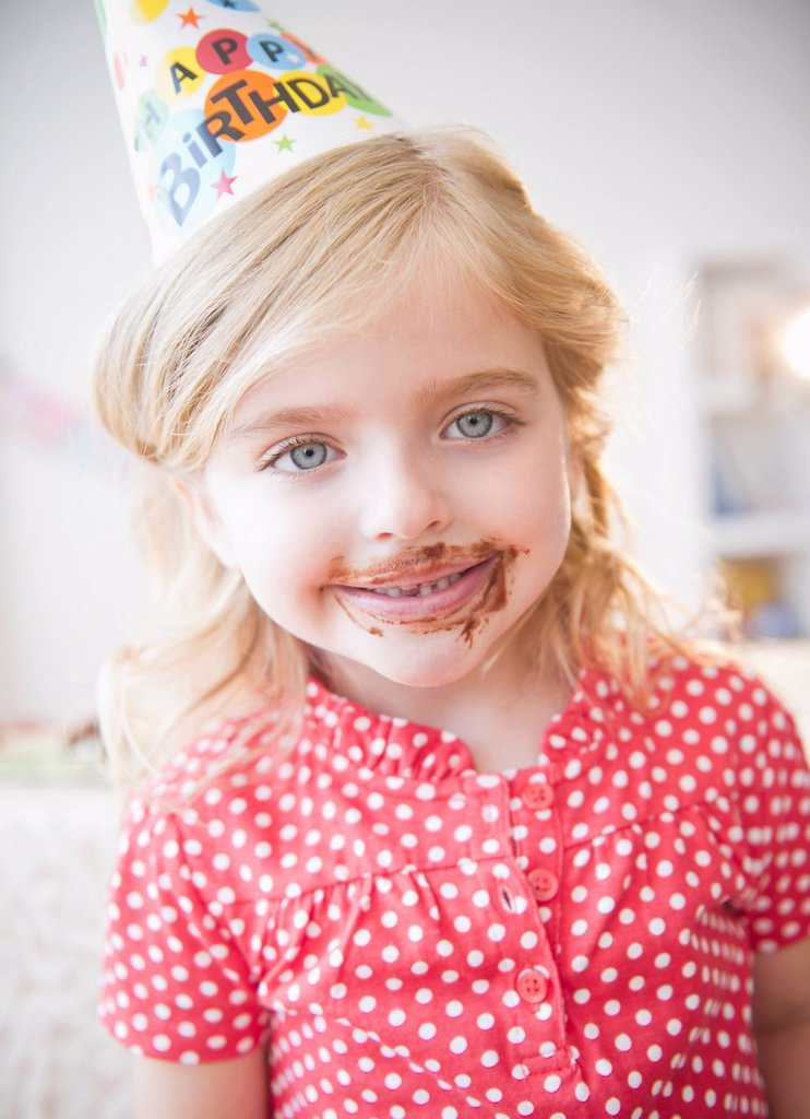 Stock Photo: 1589R-158045 Caucasian girl at birthday party with chocolate on her face