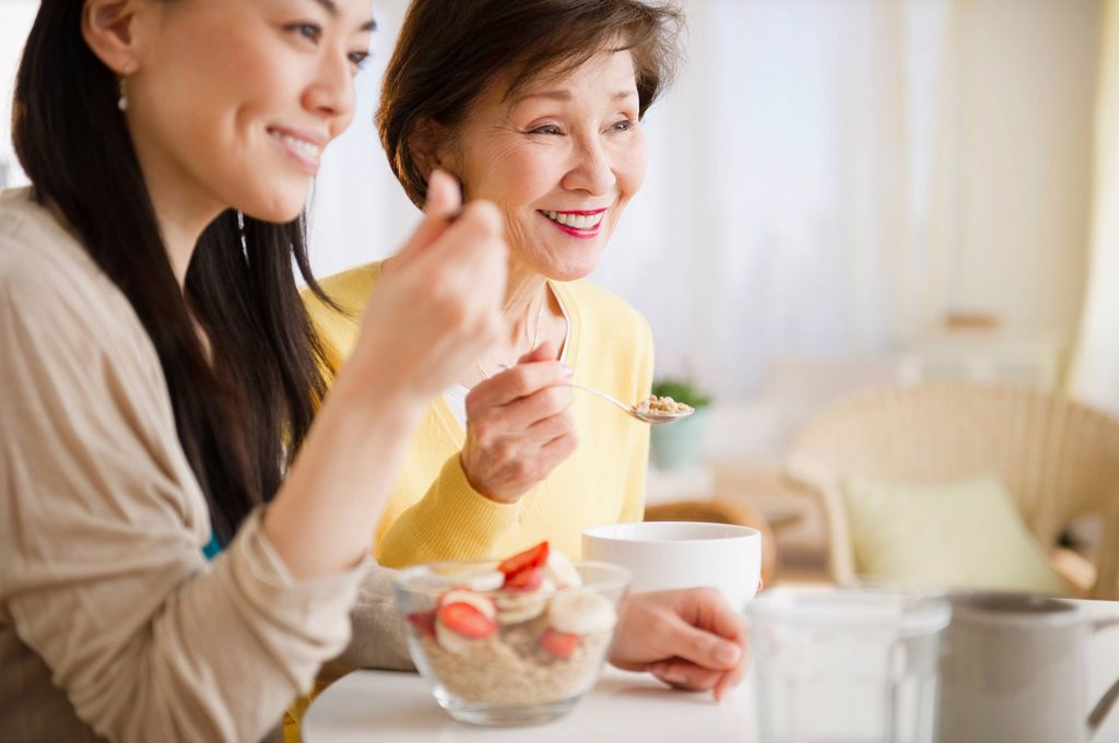 Stock Photo: 1589R-158252 Japanese mother and daughter having breakfast together
