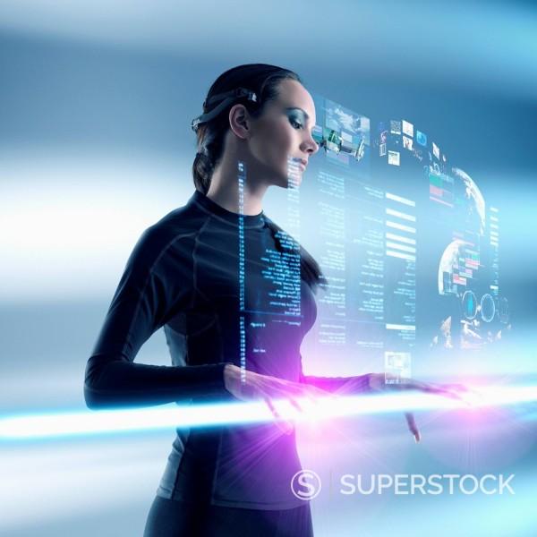Futuristic Pacific Islander woman using digital screen : Stock Photo