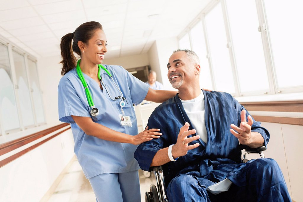 Stock Photo: 1589R-158914 Nurse comforting patient in wheelchair in hospital